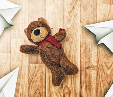 Teddy bear on real wood floor